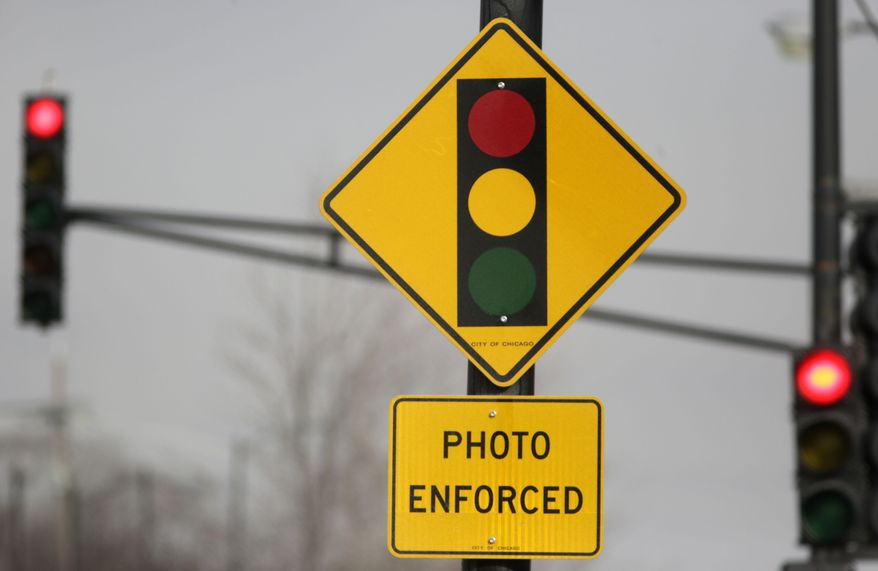 FILE -In 2017, AAA found that red-light cameras since 2013 were issuing $150 fines for cars that made rolling right-on-red turns, as well as for cars that ran through red lights. But the actual fine for a rolling right turn is $50, meaning the cameras were overcharging those violators $100 per ticket.