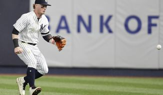 New York Yankees right fielder Clint Frazier goes after Boston Red Sox Michael Chavis's RBI triple as it bounces away from him during the eighth inning of a baseball game, Sunday, June 2, 2019, in New York. (AP Photo/Kathy Willens)