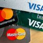 This Wednesday, Feb. 20, 2019, photo shows logos for credit cards in Zelienople, Pa. On Thursday, March 7, the Federal Reserve releases its January report on consumer borrowing. (AP Photo/Keith Srakocic)