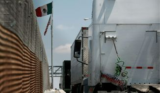Trucks line up at the Corboba - LasAmericas international bridge to cross with their cargo from Mexico into the United States, in Ciudad Juarez, Mexico, Friday, May 31, 2019. President Andrs Manuel Lpez Obrador said Friday that Mexico won't panic over U.S. President Donald Trump's threat of coercive tariffs, measures that economists say could have dramatic consequences for both nations and potentially spur a full-blown trade war. (AP Photo/Christian Torrez)