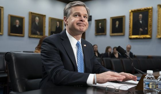 FBI Director Christopher Wray arrives to deliver his budget request to a House Appropriations subcommittee, on Capitol Hill in Washington, Thursday, April 4, 2019. (AP Photo/J. Scott Applewhite)