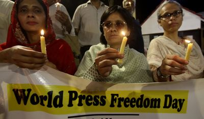 Pakistani journalists attend a candlelight vigil to observe the World Press Freedom Day, which was declared by the U.N. General Assembly in 1993, on Friday, May 3, 2019, in Karachi, Pakistan. (AP Photo/Fareed Khan)