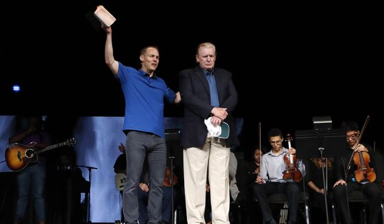 Pastor David Platt, left, prays for President Donald Trump at McLean Bible Church, in Vienna, Va., Sunday, June 2, 2019. (AP Photo/Jacquelyn Martin)