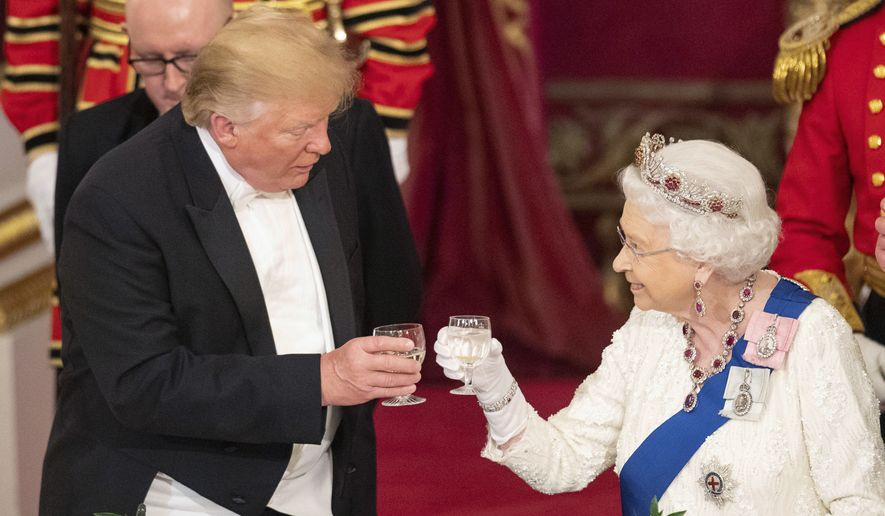 U.S. President Donald Trump, left, and Queen Elizabeth II toast, during the State Banquet at Buckingham Palace, in London, Monday, June 3, 2019. Trump is on a three-day state visit to Britain. (Dominic Lipinski/Pool Photo via AP)