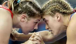 In this Aug. 18, 2016, file photo, United States' Helen Louise Maroulis, right, and Ukraine's Yuliia Khavaldzhy Blahinya compete during the women's wrestling freestyle 53-kg competition at the 2016 Summer Olympics in Rio de Janeiro, Brazil. The NCAA committee on women's athletics is recommending all three divisions add women's wrestling as an emerging sport, a key step toward making it a championship-level sport. (AP Photo/Charlie Riedel, File) **FILE**