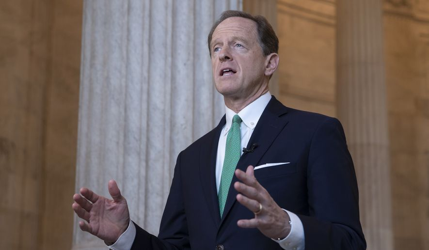 In this Oct. 2, 2018, file photo, Sen. Pat Toomey, R-Pa., speaks during a television news interview on Capitol Hill in Washington. (AP Photo/J. Scott Applewhite, file)