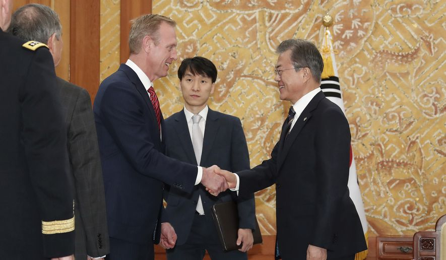 South Korean President Moon Jae-in, right, shakes hands with acting U.S. Secretary of Defense Patrick Shanahan during a meeting at the presidential Blue House in Seoul, South Korea, Monday, June 3, 2019. Shanahan arrived in Seoul on Sunday for a two-day visit to discuss the situation on the Korean Peninsula and ways to boost the alliance between the two countries. (Bae Jae-man/Yonhap via AP)