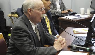 Alaska Senate Finance Committee Co-chair Bert Stedman, foreground, testifies before the Senate Rules Committee on Monday, June 3, 2019, in Juneau, Alaska. The committee advanced a bill that would pay a $1,600 Alaska Permanent Fund dividend using various funding sources. (AP Photo/Becky Bohrer)