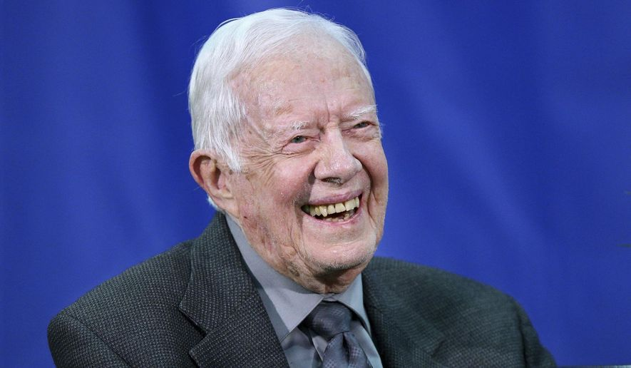 In this Sept. 18, 2018, file photo, former President Jimmy Carter answers questions from students during his annual town hall with Emory University freshman in the campus gym in Atlanta. (Curtis Compton/Atlanta Journal-Constitution via AP, File)