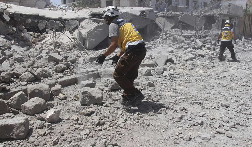 CORRECTS DATE TO MONDAY JUNE 3 -- This photo posted and provided by the Syrian Civil Defense White Helmets, which has been authenticated based on its contents and other AP reporting, shows Civil Defense workers searching for victims under the rubble after an airstrike by Syrian government forces hit the village of Ehsim, in Jabal al-Zawiya, some 10 kilometers (6 miles) north of the town of Maarat al-Numan in Idlib, Syria, Monday, June 3, 2019. The Britain-based Syrian Observatory for Human Rights, an opposition war monitor, said on Monday that Syrian troops had reached Qassaibyeh, a village deep within the last rebel stronghold in the northwest province of Idlib, after intense clashes with militants. (Syrian Civil Defense White Helmets via AP)