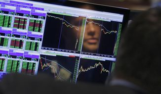 FILE- In this Aug. 24, 2015, file photo specialist Frank Masiello is reflected in his screen on the floor of the New York Stock Exchange. U.S. stocks were mixed in early trading Monday, June 3, 2019, as investors looked to shake off the steep losses incurred in May. Energy and health care stocks led most sectors higher, although declines in some major technology and internet companies limited the gains.  (AP Photo/Richard Drew, File)