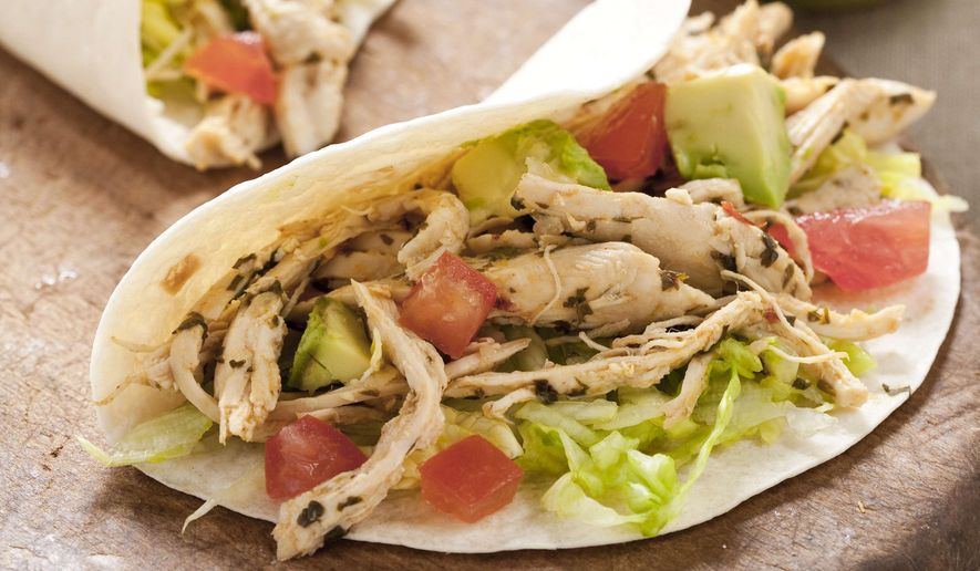 Watch for restaurant specials on tacos this Friday, which is National Taco Day. (Associated Press/File)