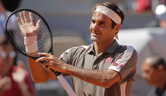 Switzerland's Roger Federer celebrates winning his fourth round match of the French Open tennis tournament against Argentina's Leonardo Mayer in three sets, 6-2, 6-3, 6-3, at the Roland Garros stadium in Paris, Sunday, June 2, 2019. (AP Photo/Michel Euler)