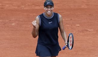 Madison Keys of the U.S. celebrates winning her fourth round match of the French Open tennis tournament against Katerina Siniakova of the Czech Republic in two sets, 6-2, 6-4, at the Roland Garros stadium in Paris, Monday, June 3, 2019. (AP Photo/Pavel Golovkin)