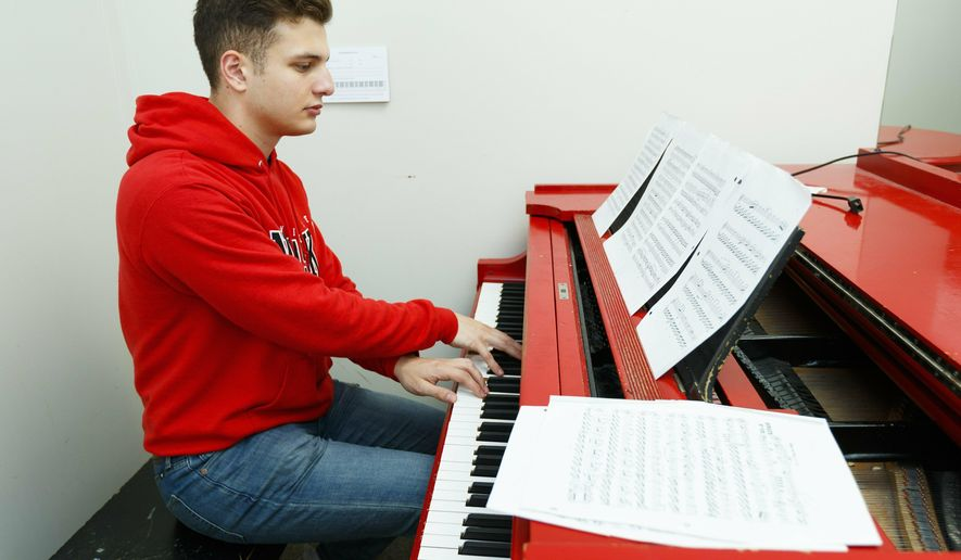 Jared Noetzel practices the piano Tuesday, May 28, 2019, in Lincoln, Neb. Noetzel said he plays music to help deal with the stress of being a medical student. (Ryan Soderlin/The World-Herald via AP)