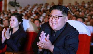 "In this June 2, 2019, photo provided on Monday, June 3, 2019, by the North Korean government, North Korean leader Kim Jong-un, right, and his wife Ri Sol Ju, left, clap hands in a musical performance by the wives of Korean People's Army officers in North Korea. The content of this image is as provided and cannot be independently verified. Korean language watermark on image as provided by source reads: ""KCNA"" which is the abbreviation for Korean Central News Agency. (Korean Central News Agency/Korea News Service via AP)"