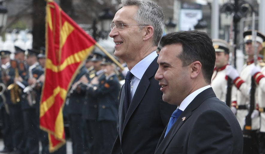 NATO Secretary General Jens Stoltenberg, accompanied by North Macedonia Prime Minister Zoran Zaev, right, during a welcome ceremony upon his arrival at the government building in Skopje, North Macedonia, Monday, June 3, 2019. NATO chief Jens Stoltenberg arrived for a two-day visit to North Macedonia before this tiny Balkan country officially becomes the alliance's 30th member by the end of the year. (AP Photo/Boris Grdanoski)