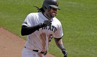 This May 23, 2019, file photo shows Pittsburgh Pirates' Josh Bell rounding third after hitting a solo home run off Colorado Rockies relief pitcher Carlos Estevez during the seventh inning of a baseball game in Pittsburgh.The first baseman is hitting home runs at a historic rate for the 138-year-old franchise thanks to an approach that's centered on consistency and not constant tinkering. (AP Photo/Gene J. Puskar/File)