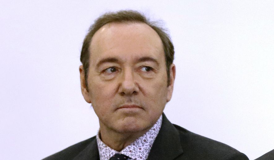 In this Jan. 7, 2019, file photo, actor Kevin Spacey stands in district court during an arraignment on a charge of indecent assault and battery in Nantucket, Mass. (Nicole Harnishfeger/The Inquirer and Mirror via AP, Pool, File)