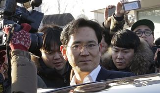 FILE - In this Feb. 5, 2018, file photo, Lee Jae-yong, vice chairman of Samsung Electronics, gets into a car to leaves a detention center in Uiwang, South Korea. Lee on Sunday, June 2, 2019, has vowed to keep up robust investments in key businesses as South Korea's leading company weathers slowing demand and the impact of trade clashes between Washington and Beijing. (AP Photo/Ahn Young-joon, File)