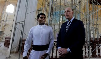 Australian Home Minister Peter Dutton, right, talks with Catholic priest Shameera Rodrigo during his visit to the St. Sebastian's church, one of the sites of Easter Sunday attacks in Negombo, Sri Lanka, Monday, June 3, 2019. More than 250 people were killed in coordinated suicide bomb attacks at three churches and three tourist hotels on Easter Sunday that were claimed by the Islamic State group and carried out by a local radicalized Muslim group. (AP Photo/Eranga Jayawardena)