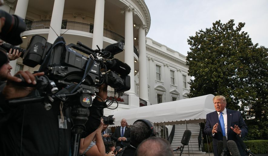 President Donald Trump speaks to the media as he departs the White House, Sunday June 2, 2019, in Washington, en route to London. (AP Photo/Jacquelyn Martin)