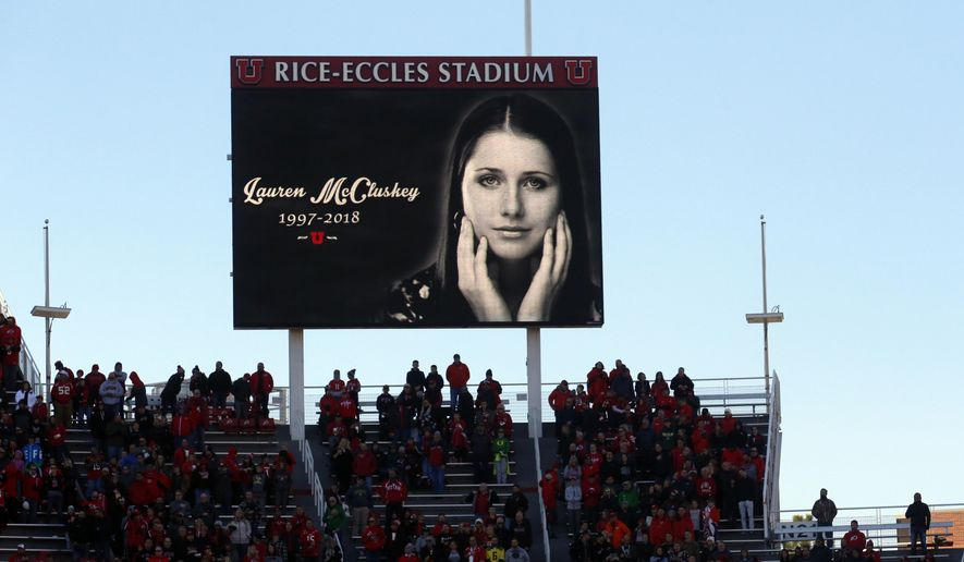In this Nov. 10, 2018, file photo, a photograph of University of Utah student and track athlete Lauren McCluskey, who was fatally shot on campus, is projected on the video board before the start of an NCAA college football game between Oregon and Utah in Salt Lake City. (AP Photo/Rick Bowmer, File)