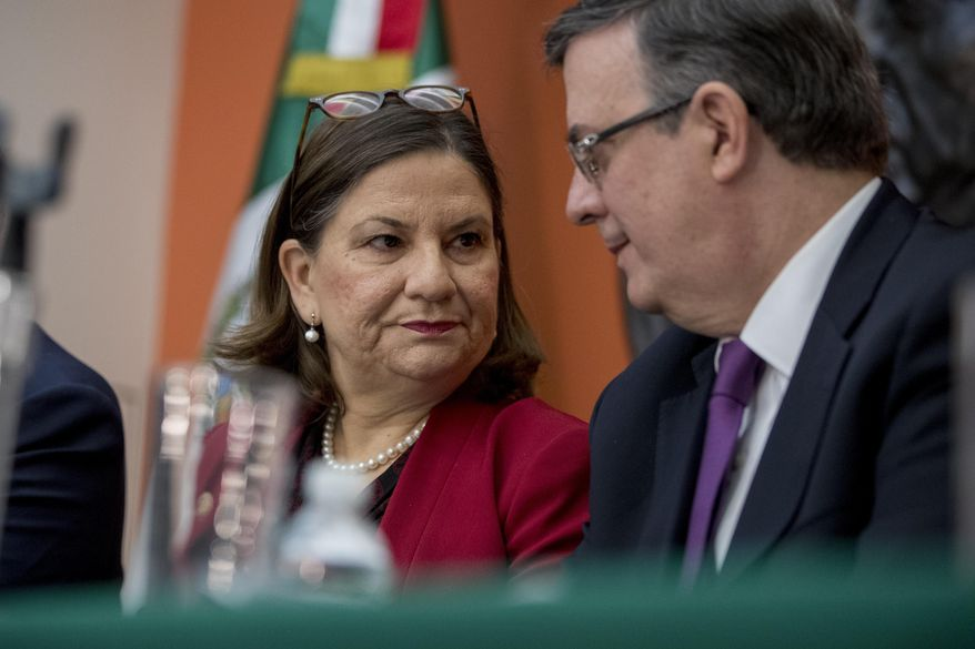Mexican Ambassador Martha Barcena Coqui, left, and Mexican Foreign Affairs Secretary Marcelo Ebrard speak during a news conference at the Mexican Embassy in Washington, Monday, June 3, 2019, as part of a Mexican delegation in Washington for talks following trade tariff threats from the Trump Administration. (AP Photo/Andrew Harnik)