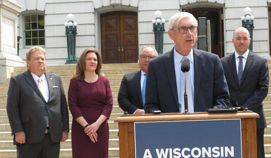 Wisconsin Gov. Tony Evers stands outside the state Capitol to announce a new partnership designed to increase insurance enrollment on Monday, June 3, 2019, in Madison, Wis. Evers also says he won't rule out accepting a transportation funding plan that doesn't have a gas tax increase. (AP Photo by Scott Bauer)