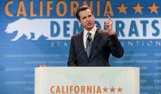 FILE - In this May 16, 2015, file photo, then California Lt. Gov. Gavin Newsom speaks at the California Democrats State Convention in Anaheim, Calif. Newsom is preparing to take the reins from Gov. Jerry Brown. It's the first time California governorship has passed from one Democrat to another in more than a century. But the two have plenty of differences. The 51-year-old Newsom says he has a deep respect for the 80-year-old Brown and is prepared to carry on his legacy, with a few changes. Newsom will be sworn in to office Monday, Jan. 7, 2019, concluding the 80-year-old Brown's four terms. (AP Photo/Damian Dovarganes, File)