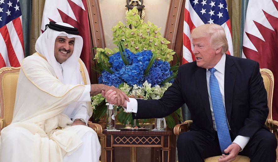 US President Donald Trump (R) and Qatar's Emir Sheikh Tamim Bin Hamad Al-Thani take part in a bilateral meeting at a hotel in Riyadh on May 21, 2017. (Photo Credit: MANDEL NGAN/AFP/Getty Images)