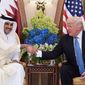 US President Donald Trump (R) and Qatar's Emir Sheikh Tamim Bin Hamad Al-Thani take part in a bilateral meeting at a hotel in Riyadh on May 21, 2017. (Photo Credit: MANDEL NGAN/AFP/Getty Images)