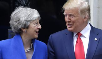 Britain's Prime Minister Theresa May greets President Donald Trump outside 10 Downing Street in central London, Tuesday, June 4, 2019. President Donald Trump will turn from pageantry to policy Tuesday as he joins British Prime Minister Theresa May for a day of talks likely to highlight fresh uncertainty in the allies' storied relationship. (AP Photo/Kirsty Wigglesworth)
