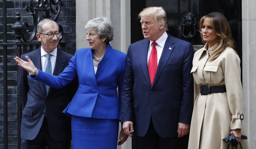 Britain's Prime Minister Theresa May and her husband Philip May, left, welcomes President Donald Trump and first lady Melania, right, outside 10 Downing Street in central London, Tuesday, June 4, 2019. President Donald Trump will turn from pageantry to policy Tuesday as he joins British Prime Minister Theresa May for a day of talks likely to highlight fresh uncertainty in the allies' storied relationship. (AP Photo/Alastair Grant)