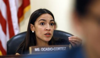 Rep. Alexandria Ocasio-Cortez, D-N.Y., questions FBI Assistant Director of the Counterterrorism Division Michael McGarrity, during a House Oversight and Reform Civil Rights and Civil Liberties subcommittee hearing on confronting white supremacy and the adequacy of the federal response, Tuesday, June 4, 2019, on Capitol Hill in Washington. (AP Photo/Jacquelyn Martin)