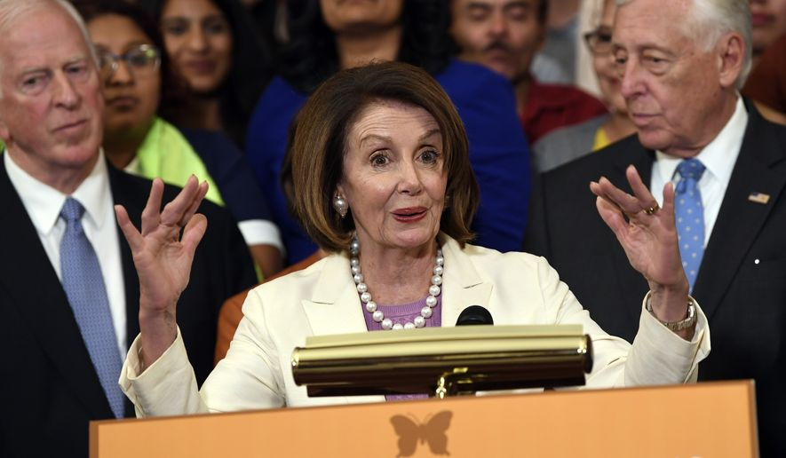 House Speaker Nancy Pelosi of Calif., center, speaks during an event on Capitol Hill in Washington, Tuesday, June 4, 2019, regarding the American Dream and Promise Act which offers a pathway to citizenship for those with Deferred Action for Childhood Arrivals (DACA), Temporary Protected Status (TPS), and Deferred Enforced Departure (DED) and similarly situated immigrants who have spent much of their lives in the United States. (AP Photo/Susan Walsh)