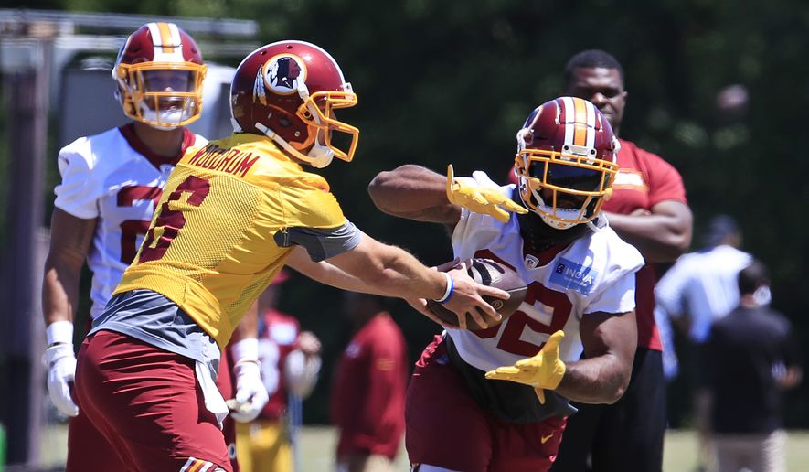 Washington Redskins quarterback Josh Woodrum (6) hands the ball to running back Samaje Perine (32) during the NFL football team's minicamp at Redskins Park in Ashburn, Va., Tuesday, June 4, 2019. (AP Photo/Manuel Balce Ceneta) **FILE**