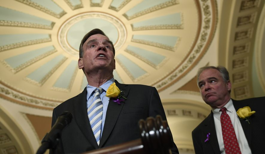 Sen. Mark Warner, D-Va., left, speaks to reporters on Capitol Hill in Washington, in this file photo from Tuesday, June 4, 2019. (AP Photo/Susan Walsh) **FILE**