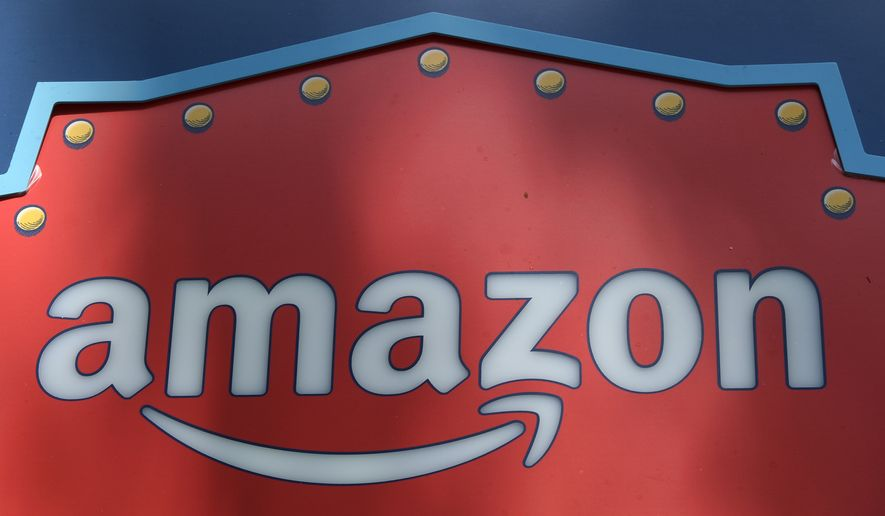 In this Oct. 23, 2018, file photo, an Amazon logo is seen atop the Amazon Treasure Truck The Park DTLA office complex in downtown Los Angeles.  (AP Photo/Richard Vogel, File) **FILE**