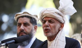 Afghanistan's President Ashraf Ghani, right, speaks during the Eid al-Fitr at the presidential palace in Kabul, Afghanistan, Tuesday, June. 4, 2019. Eid al-Fitr prayer marks the end of the holy fasting month of Ramadan in Afghanistan. (AP Photo/Rahmat Gul)