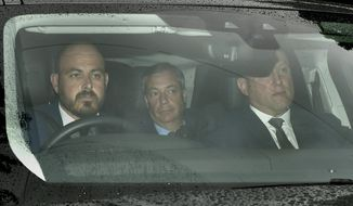 Brexit Party leader Nigel Farage, centre,  arrives at Winfield House, the residence of the Ambassador of the United States of America to the UK Woody Johnson, in Regent's Park, London, Tuesday June 4, 2019, to meet with US President Donald Trump.  (David Mirzoeff/PA via AP)