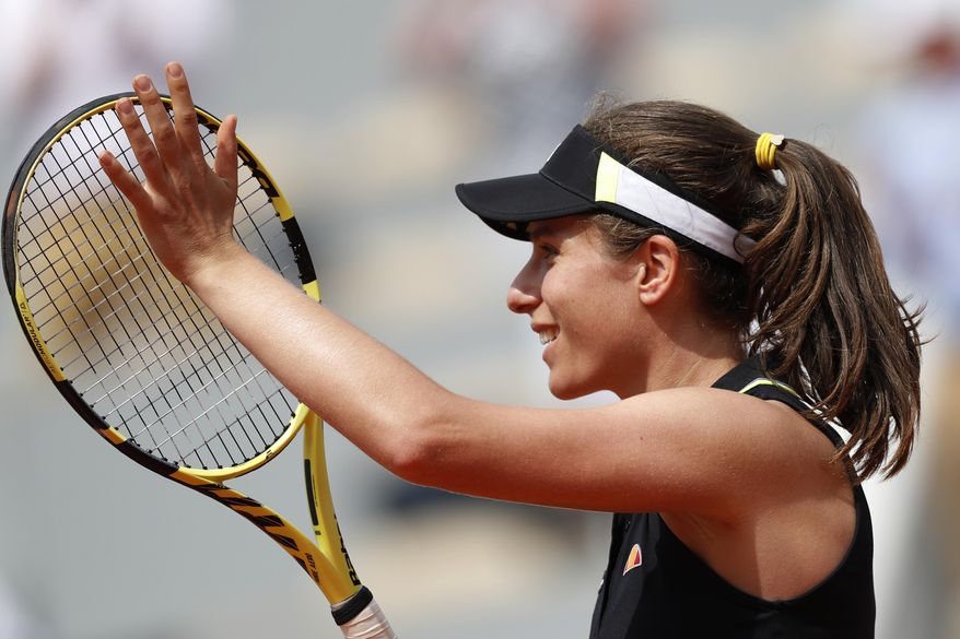 Britain's Johanna Konta celebrates winning her quarterfinal match of the French Open tennis tournament against Sloane Stephens of the U.S. in two sets, 6-1, 6-4, at the Roland Garros stadium in Paris, Tuesday, June 4, 2019. (AP Photo/Jean-Francois Badias)