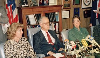 """FILE- In this March 26, 1988 file photo, prosecutor Linda Fairstein, left, is shown during a news conference in New York. Fairstein was the top Manhattan sex crimes prosecutor when five teenagers were wrongly charged with the 1989 rape and beating of a woman jogging in New York's Central Park. Since the release of the Netflix series """"When They See Us,"""" a miniseries that dramatizes the events surrounding the trial, she has resigned from at least two nonprofit boards as backlash from the case intensified. Seated at the table from left are Fairstein, District Attorney Robert Morgenthau, and Ellen Levin, whose daughter Jennifer Levin was murdered in 1986. (AP Photo/Charles Wenzelberg, File)"""