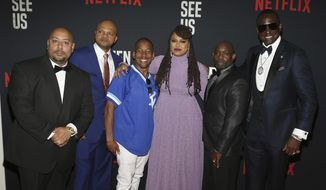 """FILE- In this May 20, 2019 file photo, Director Ava DuVernay, center, with the Central Park 5: Raymond Santana, from left, Kevin Richardson, Korey Wise, Anthony McCray and Yuesf Salaam, attend the world premiere of """"When They See Us,"""" at the Apollo Theater in New York. A former prosecutor in the Central Park Five case has resigned from at least two nonprofit boards as backlash intensified following the release of the Netflix series """"When They See Us,"""" a miniseries that dramatizes the events surrounding the trial. (Photo by Donald Traill/Invision/AP)"""