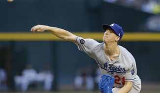 Los Angeles Dodgers pitcher Walker Buehler throws in the first inning of a baseball game against the Arizona Diamondbacks, Monday, June 3, 2019, in Phoenix. (AP Photo/Rick Scuteri)