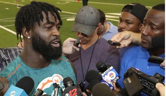 Miami Dolphins free safety Reshad Jones speaks to the news media at the team's NFL football training facility, Tuesday, June 4, 2019, in Davie, Fla. (AP Photo/Lynne Sladky)