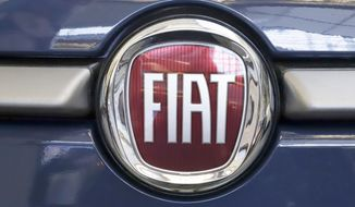 FILE - In this Feb. 14, 2019, file photo, this is the Fiat logo is mounted on a 2019 500 L on display at the 2019 Pittsburgh International Auto Show in Pittsburgh. French carmaker Renault looks set to give its approval to Fiat Chrysler's merger offer. The company's board is meeting Tuesday June 4, 2019 afternoon at its headquarters outside Paris to decide on a deal that could reshape the global auto industry. (AP Photo/Gene J. Puskar, File)