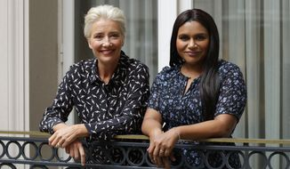 """This May 17, 2019 photo shows British actress Emma Thompson and U.S. actress and screenwriter Mindy Kaling posing on a hotel balcony in London to promote their film, """"Late Night."""" (AP Photo/Matt Dunham)"""