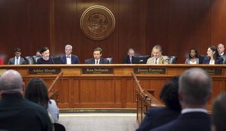 Gov. Ron DeSantis, center, presides over the Florida cabinet meeting Tuesday June 4, 2019, in Tallahassee, Fla. (AP Photo/Steve Cannon)
