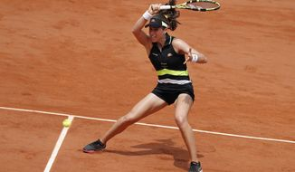 Britain's Johanna Konta plays a shot against Sloane Stephens of the U.S. during their quarterfinal match of the French Open tennis tournament at the Roland Garros stadium in Paris, Tuesday, June 4, 2019. (AP Photo/Jean-Francois Badias)